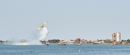 San Javier, Spain - June 10, 2018: San Javier Air Show. It is one of the most visually impressive events in the Murcia. Aerobatic teams accompanied by helicopter and parachute display teams