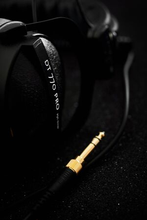 Beyerdynamic circumaural head phones over black background, for mixing, mastering, monitoring (closed) close up, nobody. Most popular and professional studio headphones market leader. Made in Germany Sajtókép