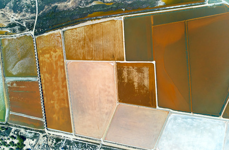Aerial panoramic birds eye view Nature Reserve of Santa Pola Salt Lakes. Drone photo of salt production and marshy area view from above. Torrevieja. Costa Blanca. Province of Alicante. Spain