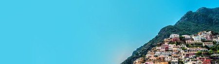 Amazing Amalfi coast hilsidehuses on mountain on the side, copy space for travel tourism advertisement o blue sky background, panoramic view, famous place for tourist italian resort Positano, Italy Фото со стока
