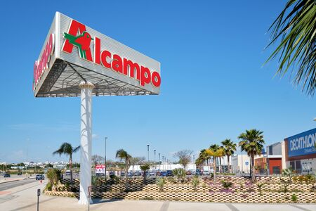 Torrevieja, Spain- May 1, 2019: Huge Alcampo signboard near shopping mall La Zenia. Alcampo (Auchan) is a French global retail group, had 639 hypermarkets and 2,412 supermarkets around the world Editorial