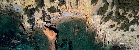 Panoramic view directly from above Palma de Mallorca rocky seaside coves turquoise colored Mediterranean Sea waters, nature background, Balearic Islands, Spain Banco de Imagens