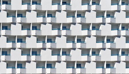 Full frame seamless background white residential house with blue glass balcony Banque d'images