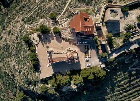 Aerial drone point of view directly from above Sanctuary of Santa Maria Magdalena monastery rooftop and surroundings countryside located in Novelda town, spanish Art Nouveau masterpiece, Spain Foto de archivo