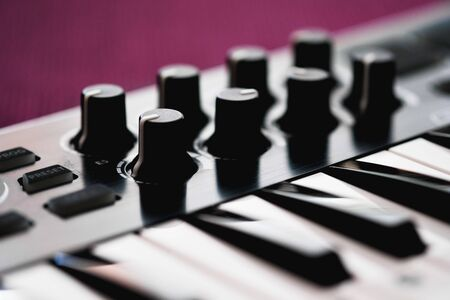 Close up image midi electronic musical keyboard, modern device, horizontal image selective focus, no people