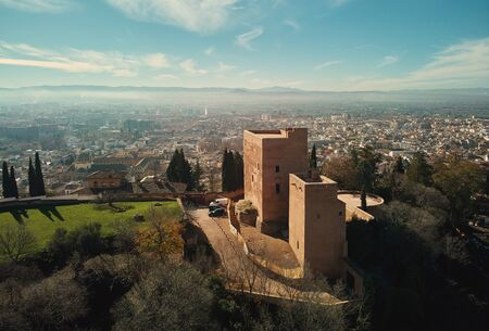 Aerial picturesque drone point of view Granada castle surrounding lands and cityscape, Alhambra or Red Castle, located on top of hill al-Sabika. Moorish palace fortress complex in Andalusia, Spain Editorial