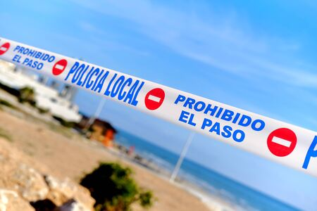 Torrevieja, Spain - March 15, 2020: Public places closed caused by pandemic disease situation. Quarantine globally spread infection. Stop COVID-19 coronavirus line restricted areas, no entry concept