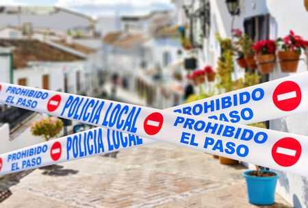 Mijas quarantined street. Public places closed caused by pandemic disease situation. Quarantine globally spread infection. Stop COVID-19 coronavirus line restricted areas, no entry concept