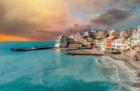 View of Bogliasco picturesque italian ancient fishing during evening light. Ancient architecture and calm Mediterranean Seascape waters view. Italy, Genoa, Europe. Travel and tourism concept