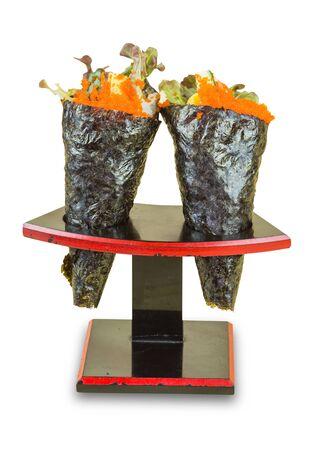 Isolated Ikura (Salmon Roe) and Kani with Avocado, Tamago Yaki (Japanese Fried Egg) and Ebiko (Prawn Egg) California or Temaki Sushi Hand Roll on Wood Stand. Foto de archivo