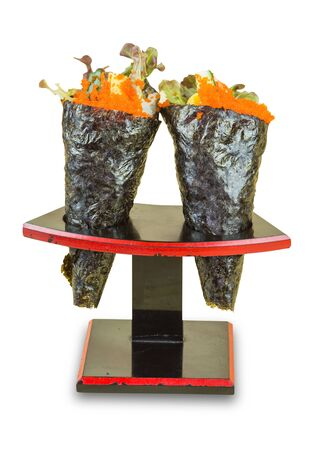Isolated Ikura (Salmon Roe) and Kani with Avocado, Tamago Yaki (Japanese Fried Egg) and Ebiko (Prawn Egg) California or Temaki Sushi Hand Roll on Wood Stand. Imagens