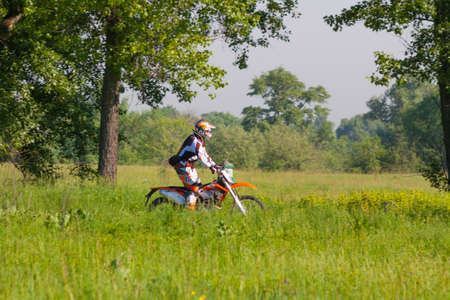motorsprot: KIEV, UKRAINE - MAY 12: Motocross rider rides in the green areas of the Park Druzby Narodov Editorial