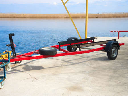 Red trailer to transport the boat on the river