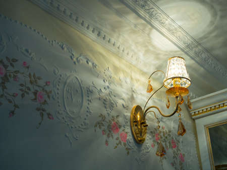 The element of the interior with classic crystal sconces