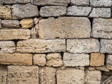porous brick: Fragment of ancient sandstone brick wall closeup