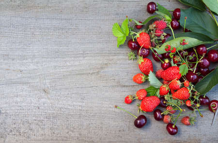 Mix of fresh, juice berries on wooden backgrounds