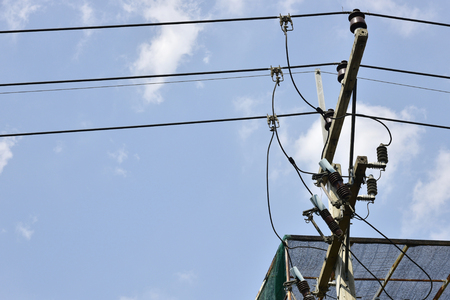 electricity pole: Electricity pole Street overlooking the blue sky with power lines. Stock Photo