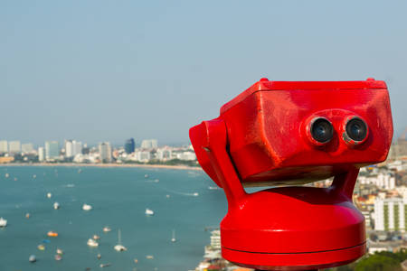 Binocular next to the waterside promenade looking out to the Bay. Stock Photo