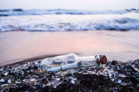 Message in a bottle on the beach.