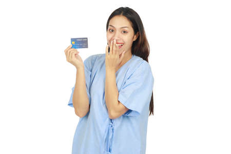 Isolated portrait of long hair beautiful woman smiling and showing credit card on white background. Business and medical concept.