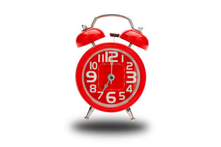 Isolated of red alarm clock for wake up on white background.