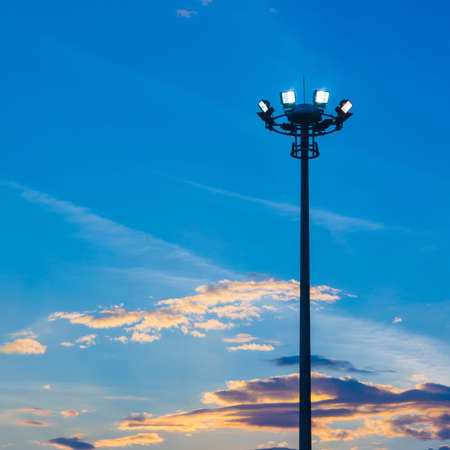 Light pole on blue sky background