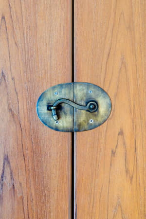 Closed wood door with lock photo