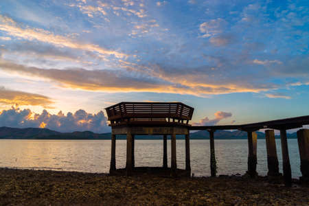 Jetty silhouette against beautiful sunset in Thailand Stock Photo
