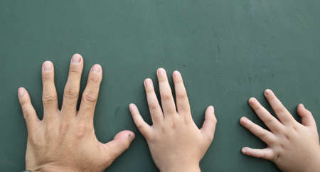 left handed: Father, brother, little brother  Stock Photo