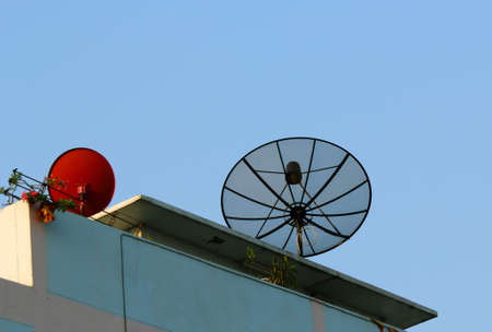 Black satellite dish receiver on the roof Stock Photo - 17471647