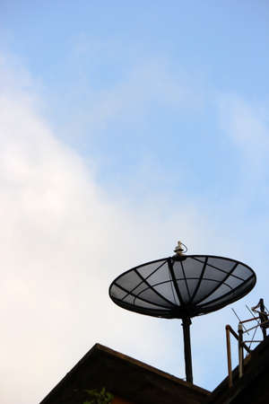 parabolic mirror: A satellite dish on the roof  Stock Photo