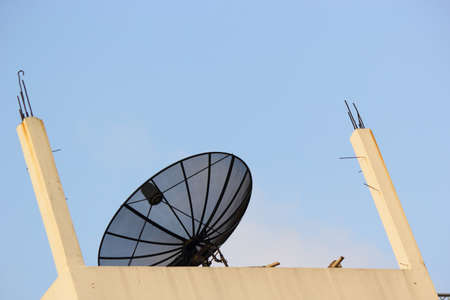Satellite antenna on the roof  Stock Photo - 20550471