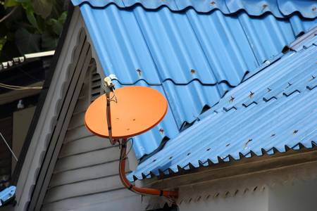 Red satellite dish on the roof  Stock Photo - 20550545