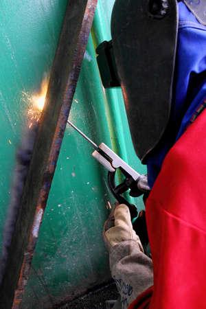 Welder welding a steel frame building
