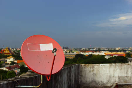 Satellite dish on the roof in the evening  Stock Photo - 21610151
