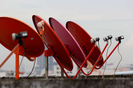 Red satellite dish lined roof  photo