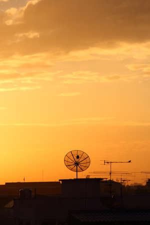 Satellite dish on the roof at dawn part 1 photo