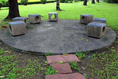Patio stone bench in the park  photo
