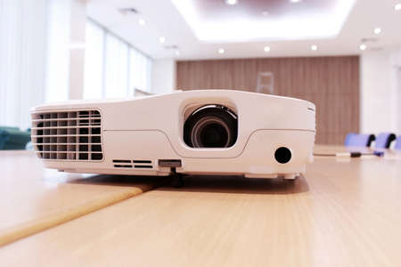 Projector on the table in the meeting room photo