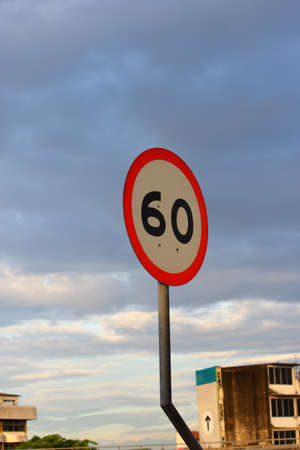 Speed limit sign 60 on sky background  Stock Photo