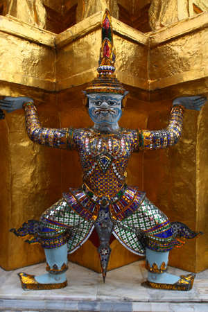Giant statue in emerald temple bangkok thailand photo