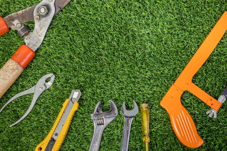 Labor day concept with construction repair tools on grass background. Space for text. Banque d'images