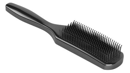Black hairbrush isolated on white background photo