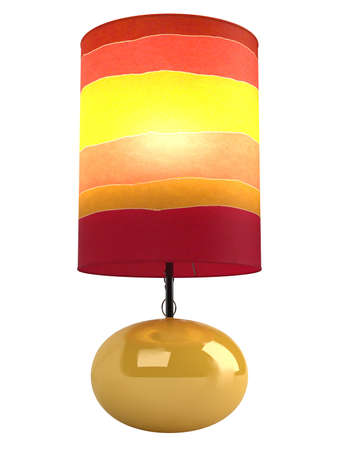 yellow  ochre: Colourful cylindrical lampshade in shades of red, yellow and orange with a burning globe and shiny oval ceramic base isolated on white Stock Photo