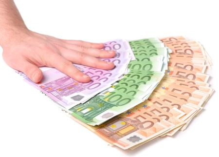 Male hand with a spray of money over white background Stock Photo - 748063