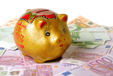 Piggy bank over bills and white background