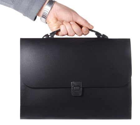 Male hand with black file briefcase over white background Stock Photo - 762905