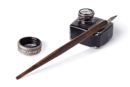 inkstand: An antique glass inkwell and wooden pen isolated over white background                           Stock Photo