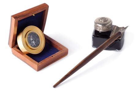 Compas, wooden box, antique glass inkwell and wooden pen isolated over white background photo
