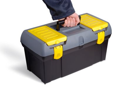 Male hand taking tool case over white background photo